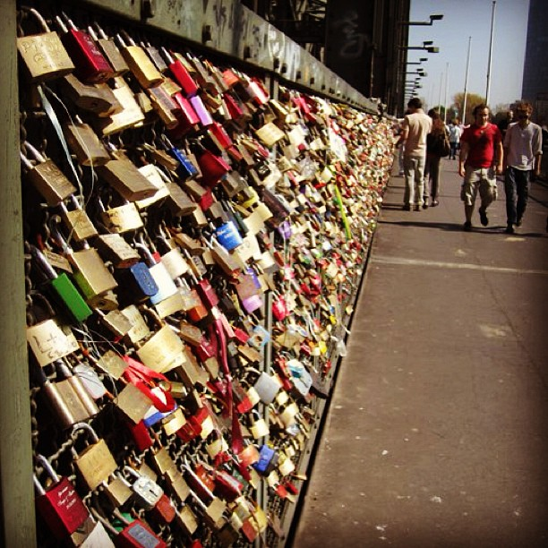 when two people got married in Cologne, they would write their names on a lock and attach it to the bridge then toss the key into the river. #throwbackthursday #germany #lovelocks #takemeback #missit #ichliebe #likeforlike #lovebridge #