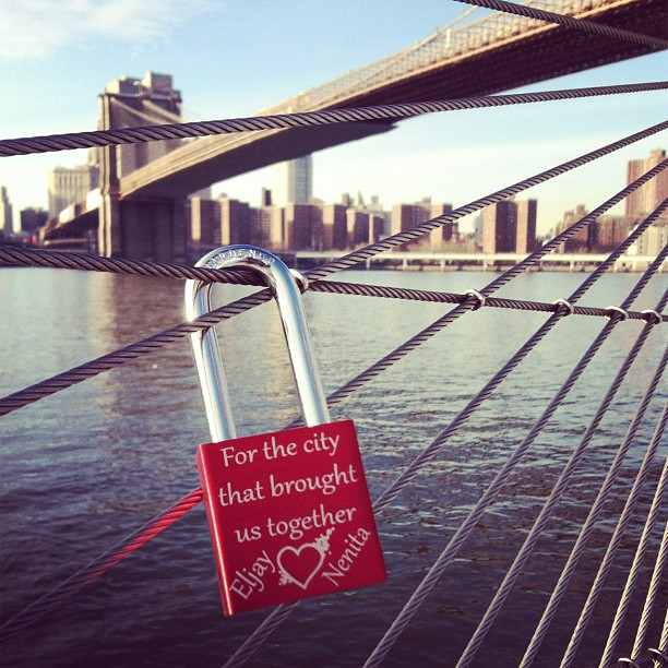 Locked our love today at Brooklyn Bridge Park with my hubby @why_i_love_new_york_city courtesy of @makelovelocks for this beautiful and meaningful lock.  Eljay and I fell in love in NYC and this symbolizes so much!! Stick around since @why_i_love_new_york_city will have a Valentine's giveaway for you all!! Much love ❤❤❤ from my family to yours! #makelovelocks #love #valentines #truelove #love #mybestfriend #bestfriends