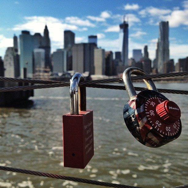 A couple of #LoveLocks seen at #BrooklynBridgePark. Lower #Manhattan in the background. ❤ </p> <span class=