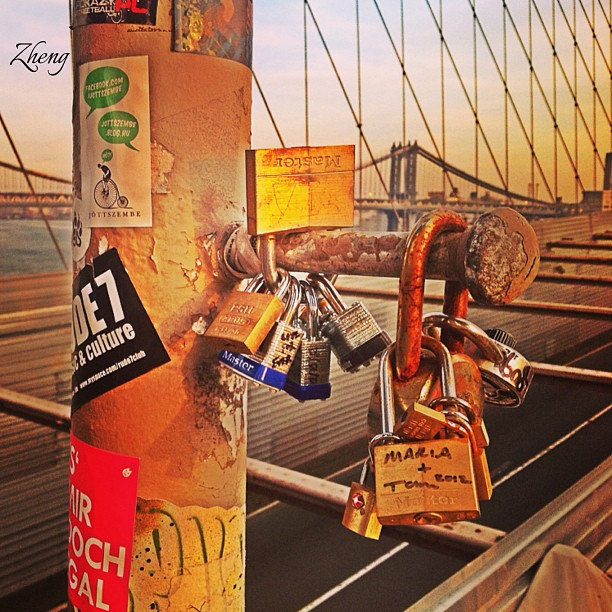 "Numerous gym locker-sized locks hang from the railings off the pedestrian path of the Brooklyn Bridge after love-struck tourists put them there following a romantic ritual birthed in Italy.  The symbolic gesture of everlasting infatuation popped up in Rome about 7 years ago as locals started copying the lustful characters in Italian author Federico Moccia's popular novel ""Ho Voglia di Te"", or ""I Want You"