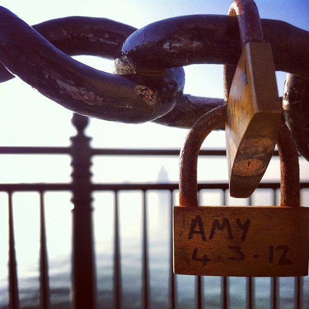 There are varied explanations for the origin of love padlocks. In Europe, love padlocks started appearing in the early 2000s. The reasons love padlocks started to appear vary between locations, and in many instances are unsourced.  An attribution for the bridge Most Ljubavi (lit. the Bridge of Love—now named after the love padlocks) in Serbia exists, where they can be traced to even before World War II. A local schoolmistress named Nada, who was from Vrnjačka Banja, fell in love with a Serbian officer named Relja. After they committed to each other Relja went to war in Greece where he fell in love with a local woman from Corfu. As a consequence, Relja and Nada broke off their engagement. Nada never recovered from that devastating blow, and after some time she died as a result of her unfortunate love. As young girls from Vrnjačka Banja wanted to protect their own loves, they started writing down their names, together with the names of their loved ones, on padlocks and affixing them to the railings of the bridge where Nada and Relja used to meet.