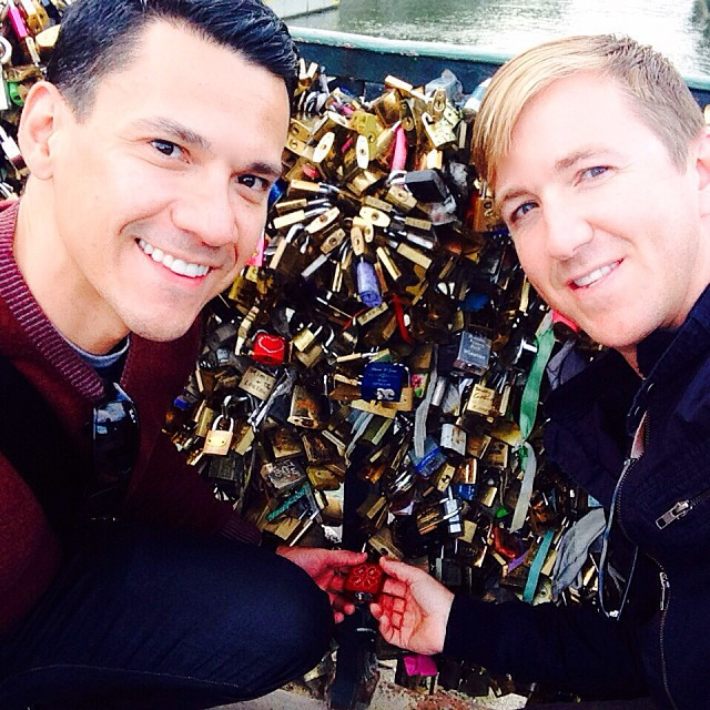 Rick and I locking our lock to one of the love lock bridges in Paris. Beautiful lock inscribed by our friends at #makelovelocks @rrg76 @makelovelocks